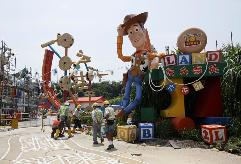 Sept. 8, 2011, file photo, workers walk past u201cToy Storyu201d character Woody at the construction site of the new attraction area Toy Story Land in Hong Kong Disneyland. A new 11-acre Toy Story Land is planned for Walt Disney World Resort near Orlando, Fla., in 2018, opening at the theme parku2019s Hollywood Studios.