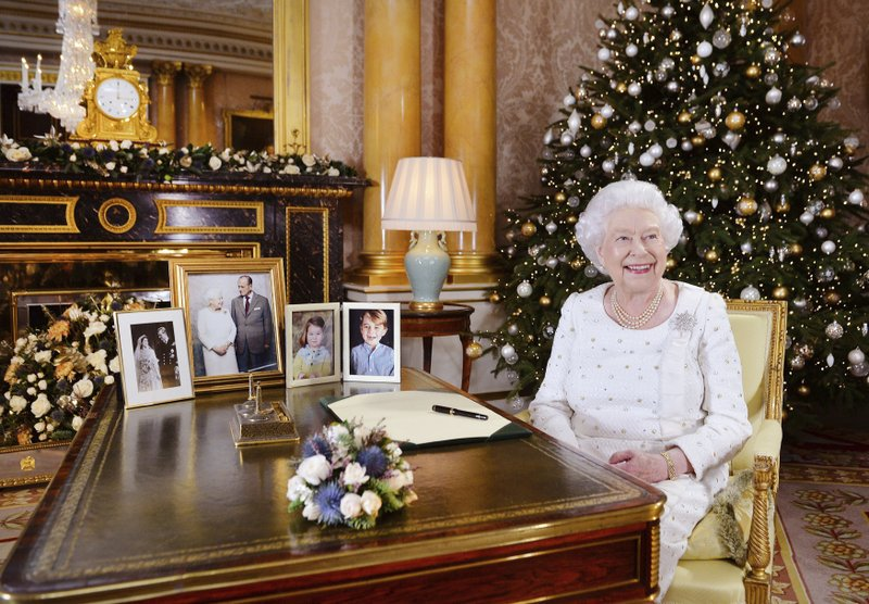 Britainu2019s Queen Elizabeth sits at a desk in the 1844 Room at Buckingham Palace, after recording her Christmas Day broadcast to the Commonwealth, in London, on December 25, 2017. Photo: AP