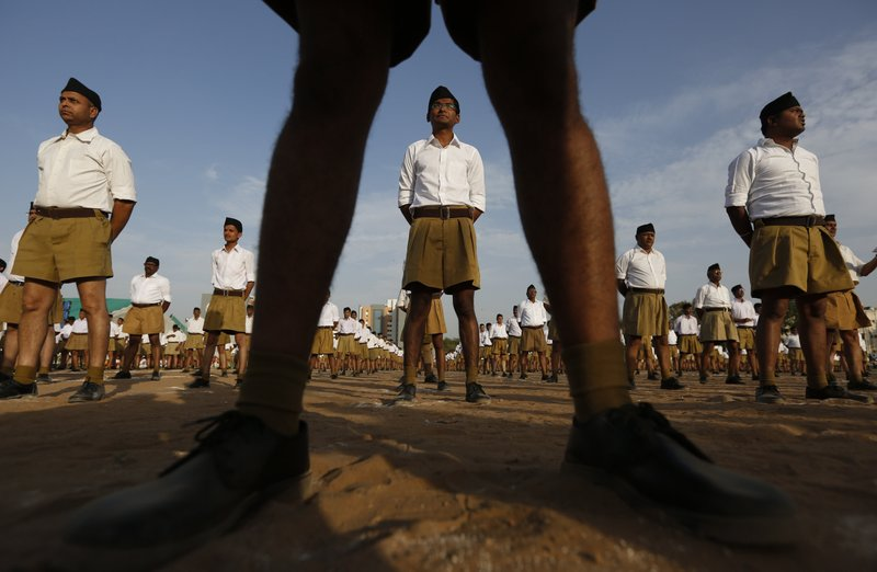Members of Hindu nationalist Rashtriya Swayamsevak Sangh (RSS), or National Volunteer Organization, stand during Varsh Pratipada festival, the Hindu New Year in Ahmadabad, India, on April 10, 2017. Photo: AP
