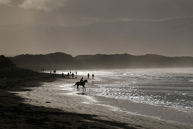 Jockey Mikey McGuane, aged 13, warms up his horse before participating in the Christmas Ballyheigue beach horse races in the County Kerry village of Ballyheigue, Ireland, on December 27, 2017. Photo: Reuters