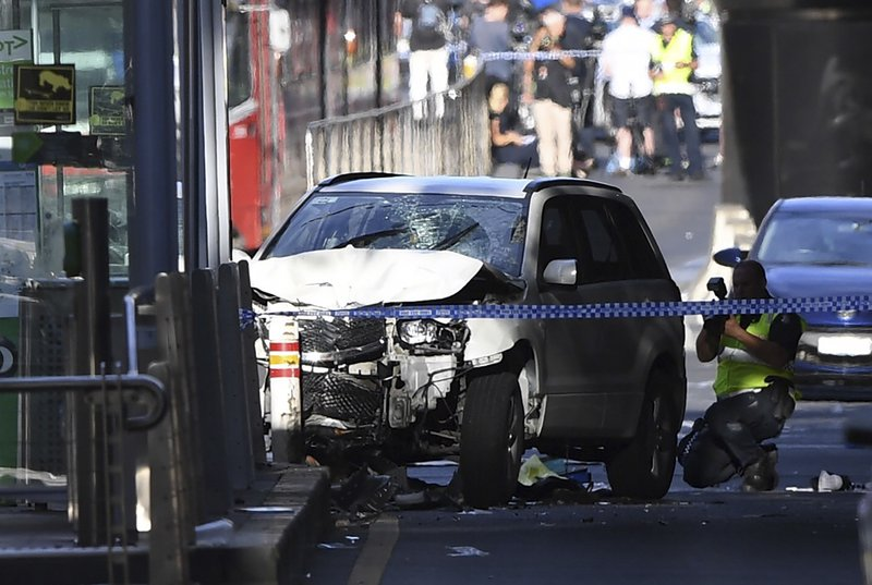 A damaged vehicle is seen at the scene of an incident on Flinders Street, in Melbourne, Thursday, December 21, 2017. Photo: AP