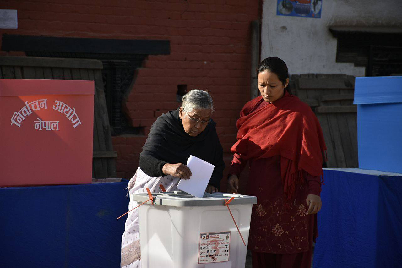 An elderly woman casts her vote in the second phase of provincial and parlaiemntary elections in Basantapur, Kathmandu, on Thursday, December 7, 2017. Photo: Naresh Shrestha