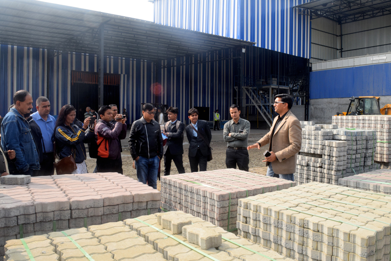 Factory owner informs the mediapersons about concrete blocks being produced in Jhapa using hi-tech German machines, on Sunday, December 17, 2017. Photo: RSS