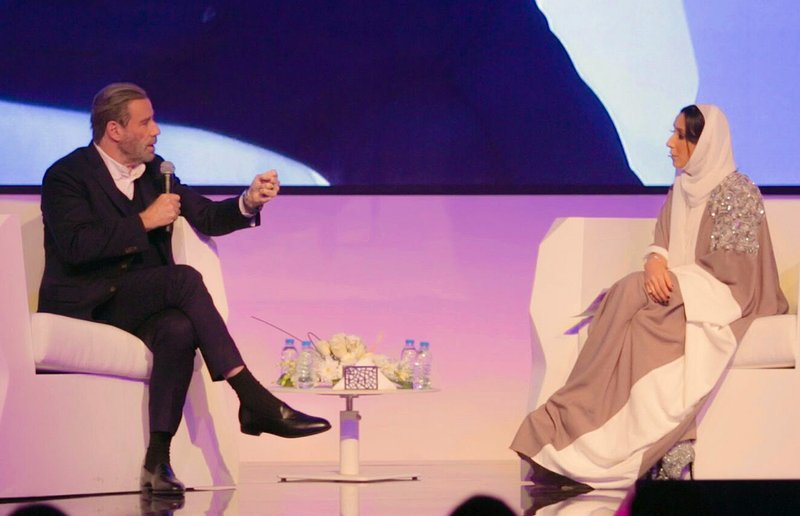 Photo released by Saudi Arabia Center for International Communication, Ministry of Culture and Information, John Travolta, left, talks at the Apex Convention Center in Riyadh on Friday, December 15, 2017.
