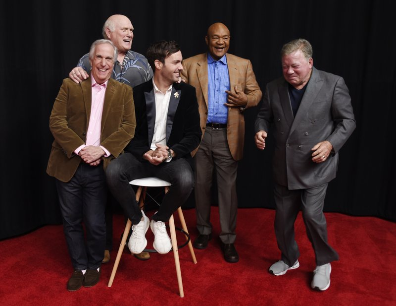 from left, Henry Winkler, Terry Bradshaw, Jeff Dye, George Foreman and William Shatner, cast members in the NBC reality series u201cBetter Late Than Never,u201d laugh as they pose together for a portrait at NBCUniversal Studios in Universal City, Calif. Foreman, Bradshaw, Winkler and Shatner traipsed through Asia during the first season of u201cBetter Late Than Neveru201d in 2016, and now the icons are taking on Europe in season two. The four icons reunite with comedian Jeff Dye for the NBC travelogue reality series premiering New Yearu2019s Day.