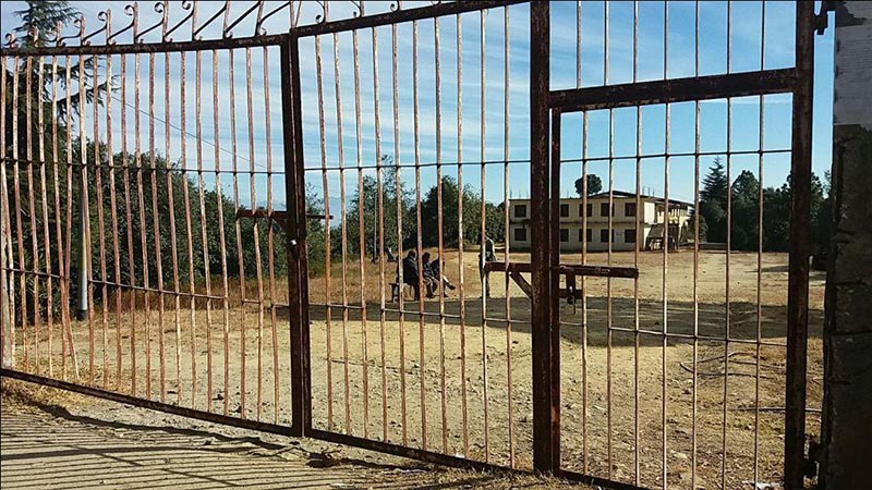 The padlocked main gate to Dadeldhura Multiple Campus, in Baghkhor, on Friday, December 22, 2017. Photo: THT