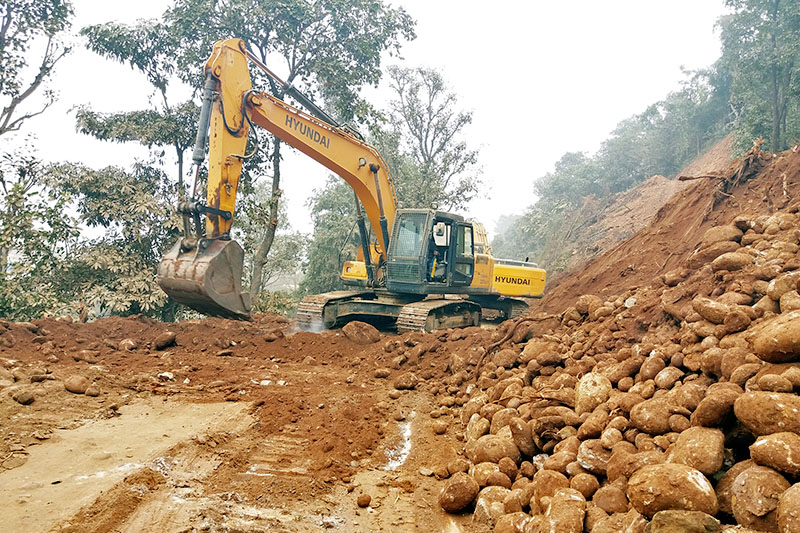 An excavator is being used for the construction of 82 km Galchi-Devighat-Trishuli-Mailung-Safrubesi-Rasuwagadi road connecting Kerung of China, in Dhading district, on Sunday, December 24, 2017. Only 10 per cent work has been completed in one of most awaited national pride projects. Photo: RSS