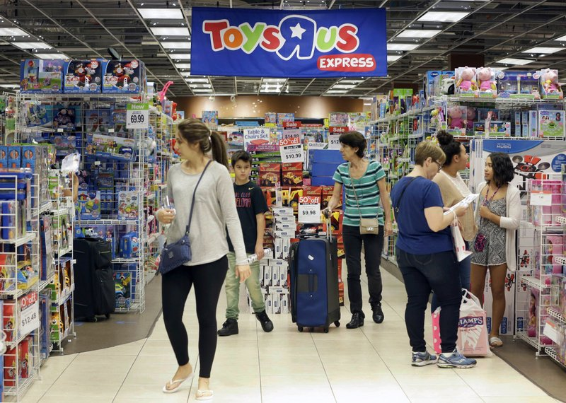 Shoppers browse at a Toys R Us store in Miami. The toys your kids unwrap this Christmas could invite hackers into your home. That Grinch-like warning comes from the FBI, which said this summer that toys connected to the internet could be a target for crooks who may listen in on conversations or use them to steal a childu2019s personal information., on Friday, 25 November, 2016. Photo: AP