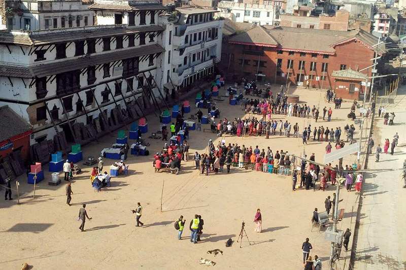 Voters are seen lined up to exercise their franchise for the provincial and parliamentary elections at Basantapur polling booth, in Kathmandu, on Thursday, December 7, 2017. Photo: Naresh Shrestha