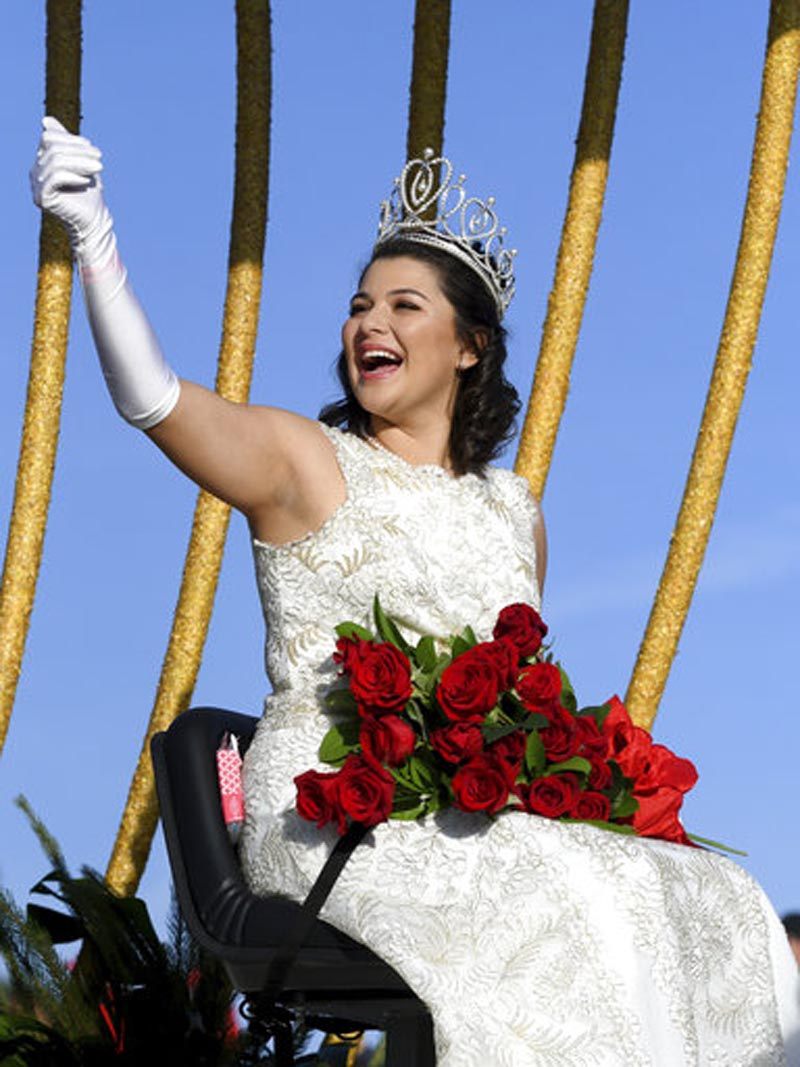 Rose Queen Isabella Marie Marez waves to the crowd at the 129th Rose Parade in Pasadena, Calif., Monday, Jan. 1, 2018. (AP Photo/Michael Owen Baker)