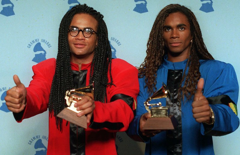 Rob Pilatus, left, and Fab Morvan of Milli Vanilli give the thumbs-up as they display their Grammys after being presented with the best new artist award in Los Angeles. The Grammys asked the duo to return the award after it was learned that Morvan and Pilatus didnu2019t sing on the duou2019s 1989 U.S. debut, u201cGirl You Know Itu2019s True.u201d