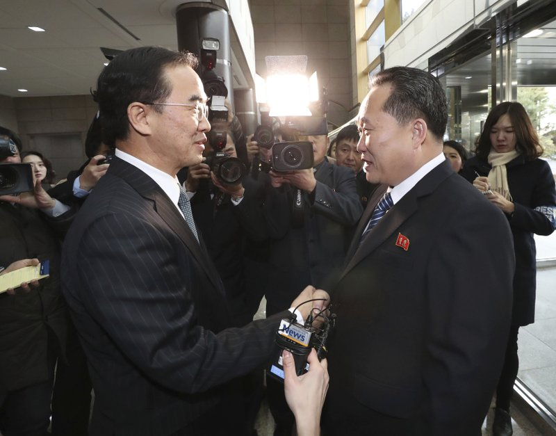 South Korean Unification Minister Cho Myoung-gyon, left, shakes hands with the head of North Korean delegation Ri Son Gwon before their meeting at the Panmunjom in the Demilitarized Zone in Paju, South Korea, Tuesday, Jan. 9, 2018. South Korean media said North and South Korea have begun talks at their border about how to cooperate in next monthu2019s Winter Olympics and how to improve their long-strained ties
