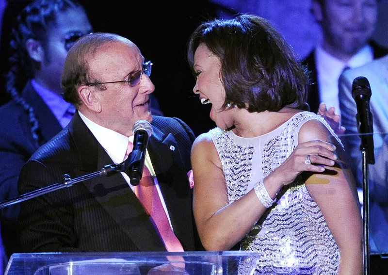 producer Clive Davis shares a moment with singer Whitney Houston performs at the pre-Grammy gala & salute to industry icons with Clive Davis honoring David Geffen in Beverly Hills, Calif. Davisu2019 gala, held a day before the 2018 Grammy Awards, launched the careers of Whitney Houston and Alicia Keys, and have featured all-stars like Aretha Franklin, Carole King, Smokey Robinson and Carly Simon. He first held the gala 42 years ago.
