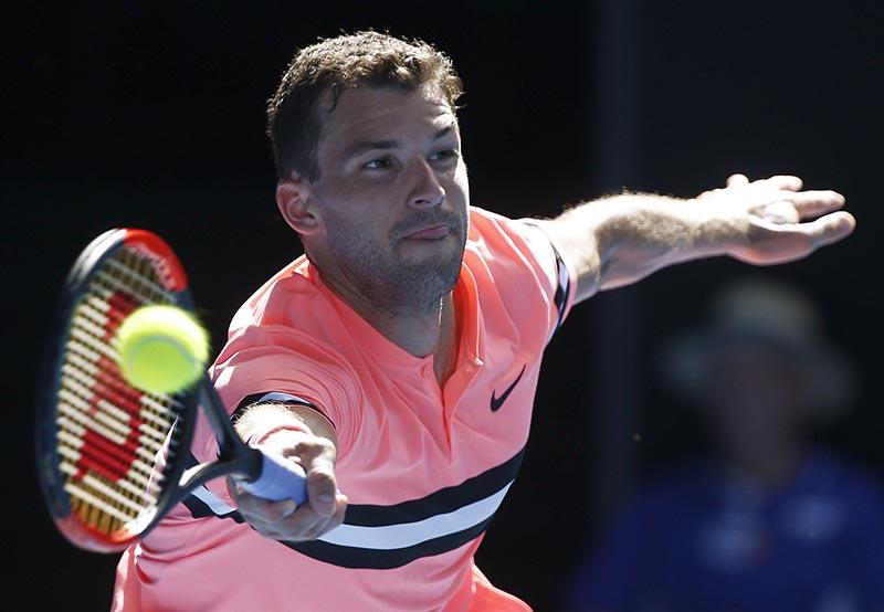 Dimitrov hits a shot during the Australian Open match between Grigor Dimitrov of Bulgaria and Dennis Novak of Austria, at Rod Laver Arena, Melbourne, Australia, on January 15, 2018. Photo: Reuters