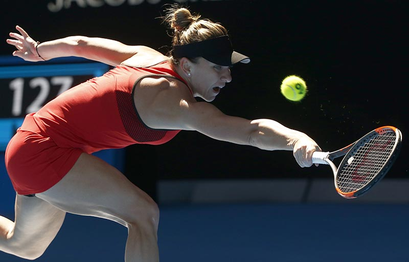 Simona Halep of Romania hits a shot against Destanee Aiava of Australia during the Australian Open , at Rod Laver Arena, in Melbourne, Australia, on January 16, 2018. Photo: Reuters