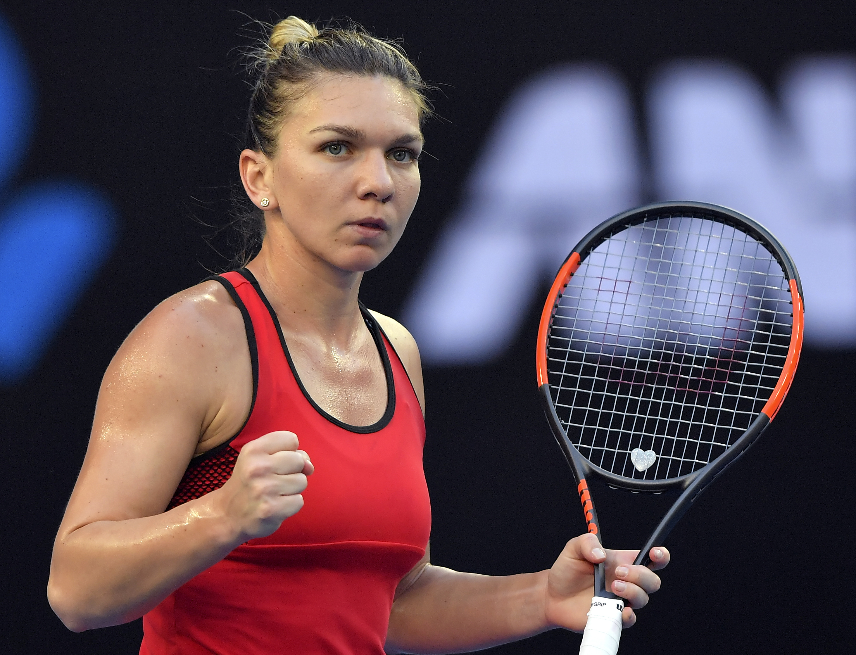 Romania's Simona Halep celebrates a point win over Canada's Eugenie Bouchard during their second round match at the Australian Open tennis championships in Melbourne, Australia, Thursday, Jan. 18, 2018. (AP Photo/Andy Brownbill)