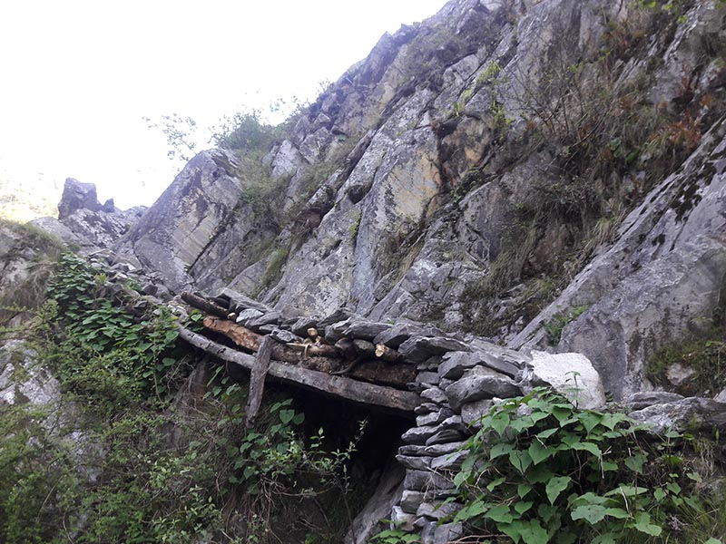 Wooden planks laid with stone to cross-over the cliffs near Phuligumba in Himali Rural Municipality-3, in Bajura district. Photo: Prakash Singh