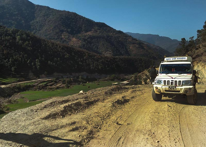 A vehicle heading towards Bajura from Khaptad Chhanna Rural Municipality of Bajhang after the construction of a direct road linking Bajura with Bajhang was completed, on Monday. Photo: THT