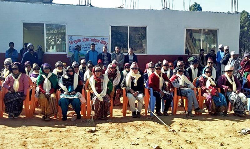 Patients pose for a photograph after their successful eye surgery in a three-day free eye camp organised in Purano Dabali, Takshar of Bhojpur district, on Saturday, January 13, 2018. Photo: Niroj Koirala