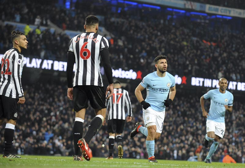 Newcastle players, at left, react after Manchester City's Sergio Aguero, 2nd right, scored his side's third goal during the English Premier League soccer match between Manchester City and Newcastle United at the Etihad Stadium in Manchester, England, Saturday, January 20, 2018. Photo: AP