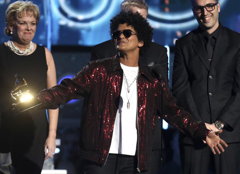 Bruno Mars accepts the award for record of the year for u009324K Magicu0094 at the 60th annual Grammy Awards at Madison Square Garden on Sunday, Jan. 28, 2018, in New York. Photo: AP