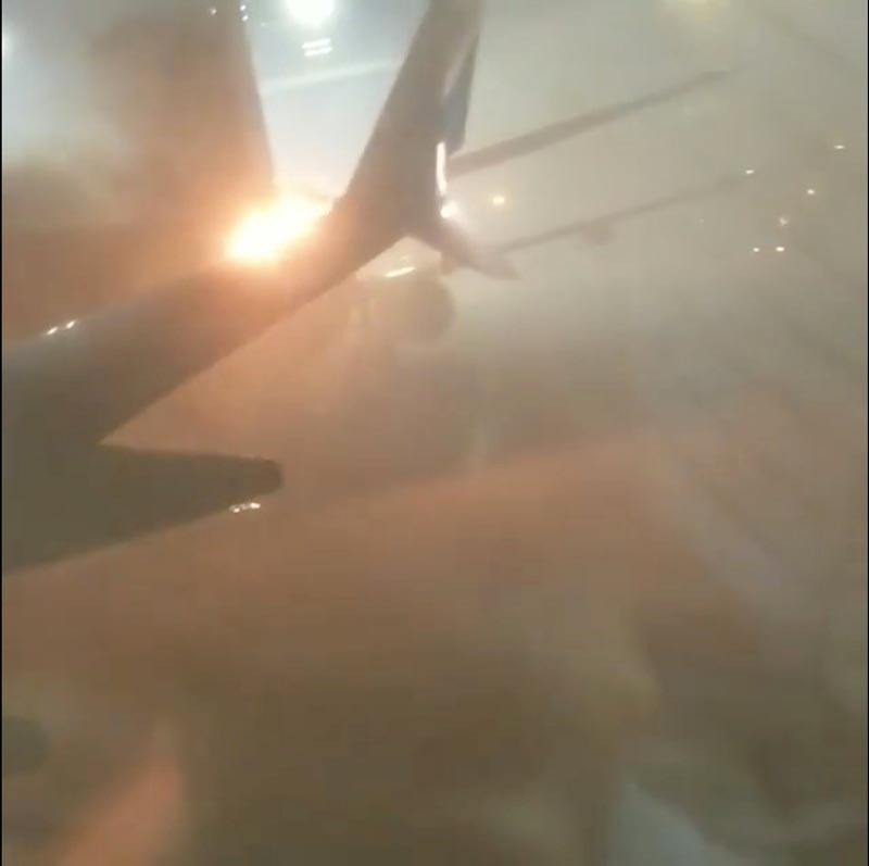 File - An explosion is seen through a window of a plane that has collided with another plane at Toronto's Pearson Airport, Canada on January 5, 2018. Photo: Reuters
