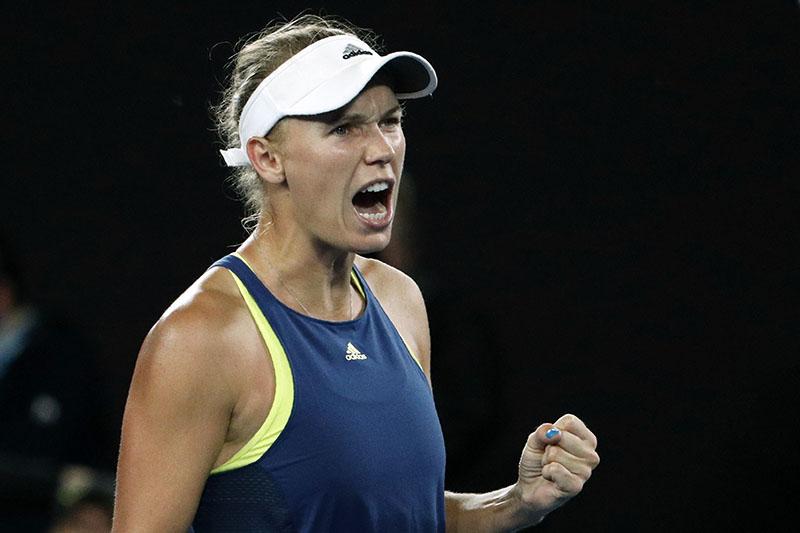 Denmark's Caroline Wozniacki reacts during her match against Spain's Carla Suarez Navarro. Photo: Reuters