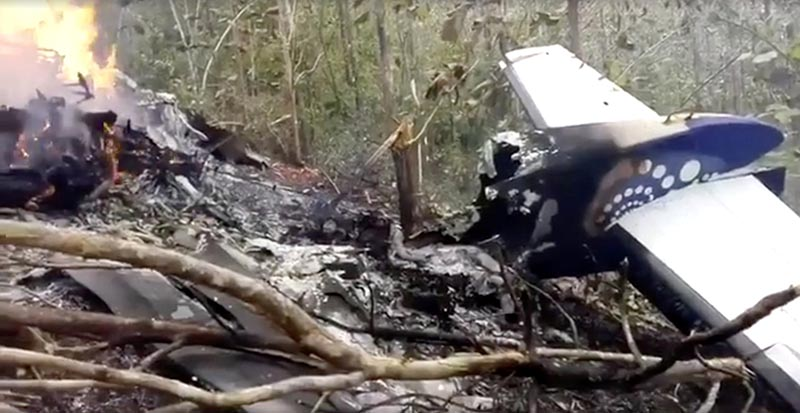 Wreckage in flames after a plane crashed in the mountainous area of Punta Islita, in the province of Guanacaste, in Costa Rica in this still image taken from social media video, on December 31, 2017. Photo:  Ministerio de Seguridad Publica de Costa Rica via Reuters