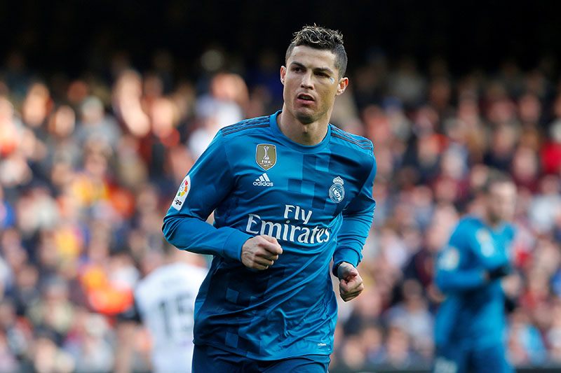 Real Madridu2019s Cristiano Ronaldo celebrates scoring their second goal from the penalty spot. Photo: Reuters