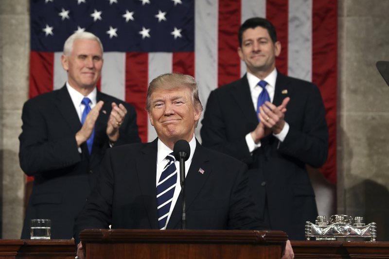 FILE - In this February 28, 2017, photo, President Donald Trump, flanked by Vice President Mike Pence and House Speaker Paul Ryan of Wis., arrives on Capitol Hill in Washington, for his address to a joint session of Congress. Photo: AP