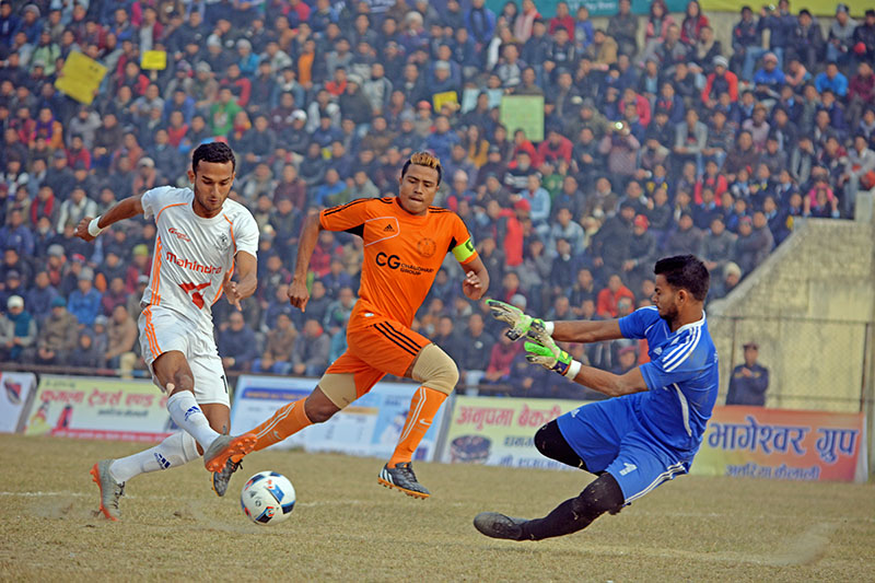 APF player tries to slot a ball past against Farwest XI goalie during the ongoing Nepal Ice Farwest Khaptard Gold Cup played at the Regional Stadium, in Dhangadhi, on Sunday, January 14, 2018. Photo: Tekendra Deuba