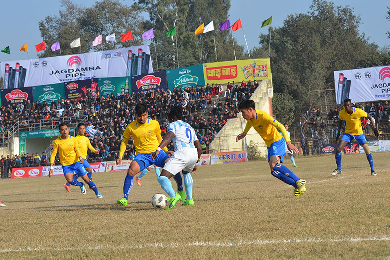 Manang Marshyangdi player tries to dribble past Rupandehi players during the Nepal Ice Farwest Khaptard Gold Cup played at the regional stadium in Dhangadhi on Friday, January 12, 2018. Photo: Tekendra Deuba