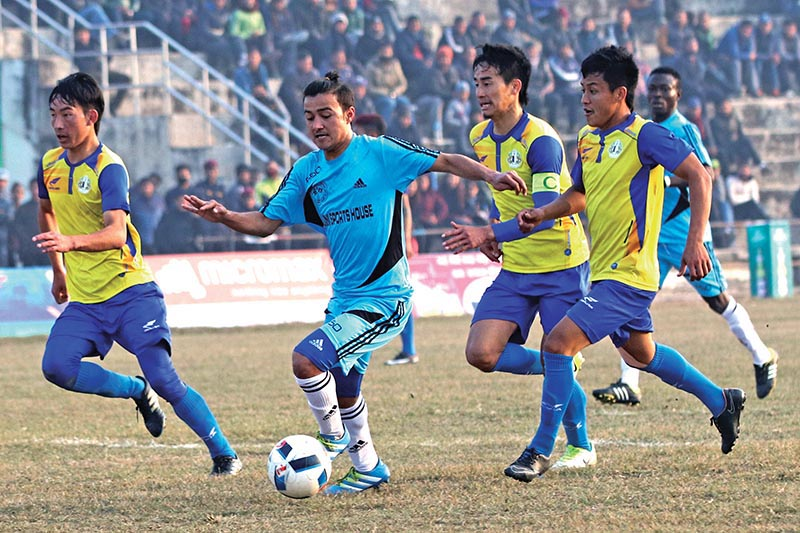 APFu2019s Anjan Bista vies with a Sankata player during their Nepal Ice Farwest Khaptad Gold Cup match in Dhangadhi on Wednesday. Photo: THT