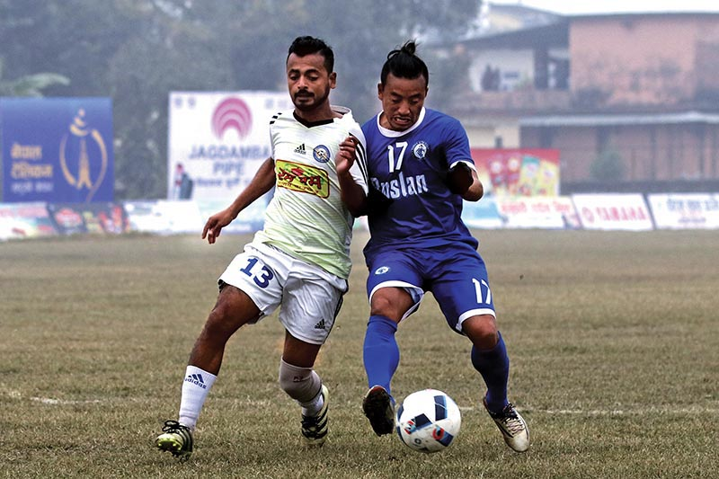 Ruslan Three Star Club's Buddha Chemjong (right) vies with a Rum Pum Jhapa-XI player during their Nepal Ice Farwest  Khaptad Gold Cup Match at the Dhangadhi Stadium in Dhangadhi on Monday. Photo: THT