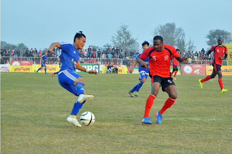Rastriya Jagriti Club player (blue jersey) tries to skip past Garifa Sporting Club Kolkata player during the match today. Photo: Santosh Kafle