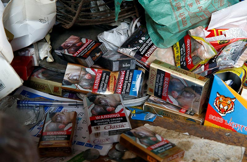 Cigarette packets with graphic pictorial warnings are pictured on the counter of a cigarette seller in Mumbai, India, on January 8, 2018. Photo: Reuters