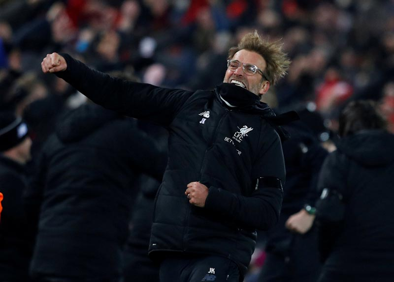 Liverpool manager Juergen Klopp celebrates a goal during the English Premier League match between Liverpool and Manchester City, at Anfield, in Liverpool, Britain, on January 14, 2018. Photo: Reuters.
