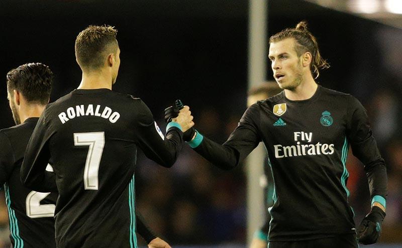 Real Madridu2019s Gareth Bale celebrates scoring their first goal with Cristiano Ronaldo during the La Liga Santander match between Celta Vigo and Real Madrid, at Balaidos, in Vigo, Spain, on January 7, 2018. Photo: Reuters