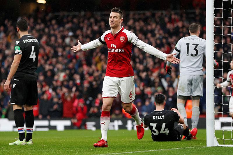 Arsenal's Laurent Koscielny celebrates scoring their third goal. Photo: Reuters