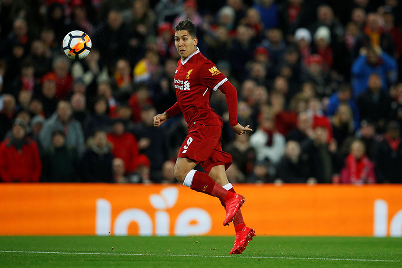 Liverpool's Roberto Firmino scores their first goal. Photo: Reuters