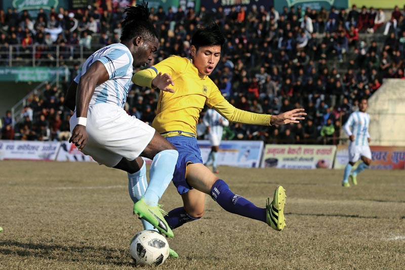 Players of Manang Marshyangdi Club (left) and Rupandehi in action during their Nepal Ice Farwest Khaptad Gold Cup Tournament match in Dhangadhi on Friday, Jan 12, 2018. Photo: THT