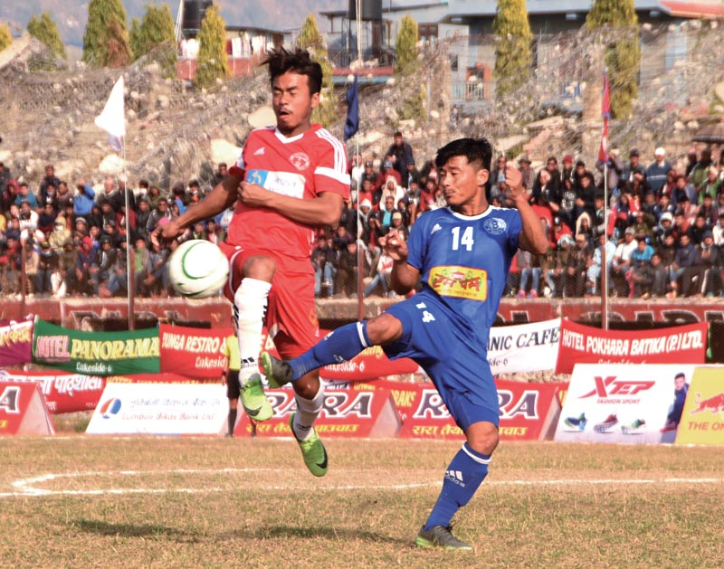File - Rumpum Jhapa's Karna Limbu (right) vies for the ball with Nepal Police Club player during their 16th Aaha Rara Gold Cup match in Pokhara on Friday, Jan 26, 2018.