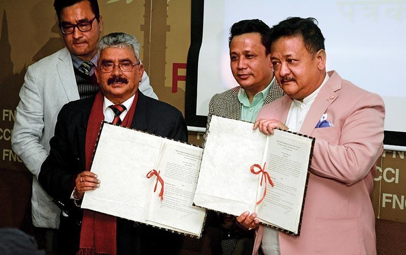 NVA President Manoranjan Raman Sharma (left) and FNCCI Vice-president UmeshLalShrestha exchange the MoU at a programme in Kathmandu on Sunday. Photo: THT