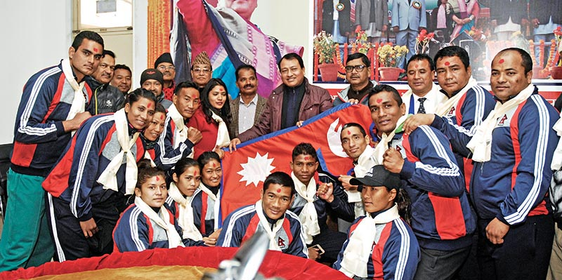 Nepali boxing team members pose for a group photo with NSC Member Secretary Keshab Kumar Bista during a farewell programme in Lalitpur on Thursday. Photo: THT
