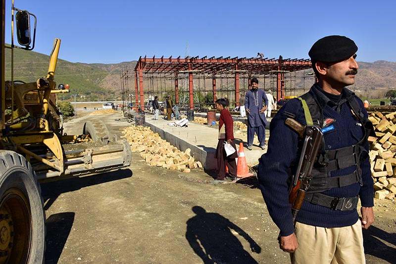 File - A Pakistani police officer stands guard at the site of Pakistan China Silk Road in Haripur, Pakistan, on December 22, 2017. Photo: AP