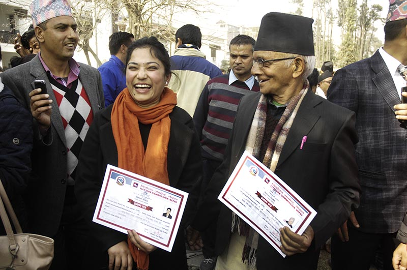 Provincial assembly members sharing a light moment after receiving their certificates, in Kathmandu, on Friday, January 19, 2018. Photo: THT