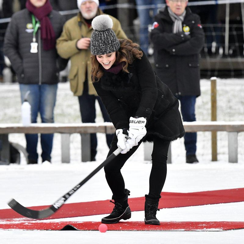 File - Britainu0092s Kate, Duchess of Cambridge tries a shot with a bandy stick in Stockholm, Sweden, during Prince William and Duchess of Cambridge 4-day visit to Sweden and Norway, on Tuesday Jan. 30, 2017. Photo: AP