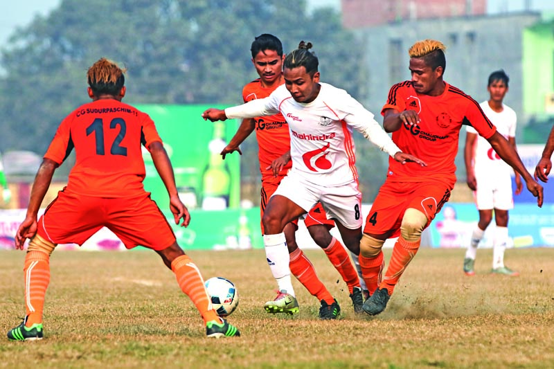 Anjan Bista (centre) of Nepal APF Club vies for the ball with Farwest Sports Club players during their Nepal Ice Farwest Khaptad Gold Cup match in Dhangadhi on Sunday. Photo: THT Print