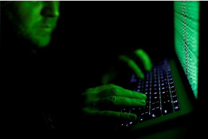 FILE-A man types on a computer keyboard in front of the displayed cyber code in this illustration picture taken on March 1, 2017. Photo: Reuters.