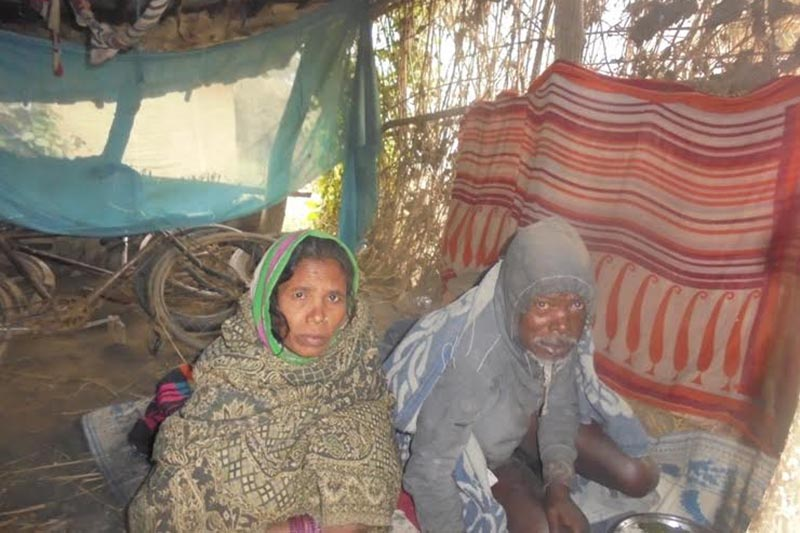 Devani Sada taking care of her paralysed husband in their hut, in Golbazaar, on Friday, January 12, 2018. Photo: THT
